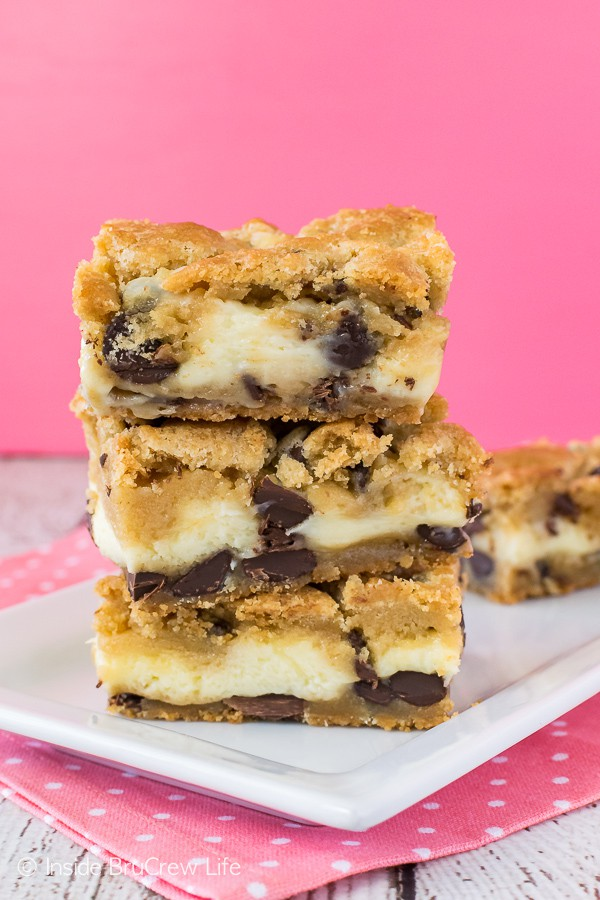 Chocolate Chip Cheesecake Cookie Bars - lots of chocolate in this homemade cookie dough makes these easy layered cookies a fun treat. Great recipe for any party or dinner!