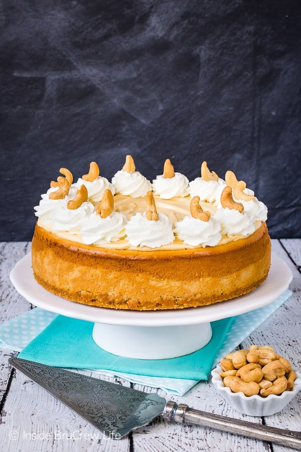 Caramel Cashew Cheesecake - the cashew crust and three times the caramel makes this full sized cheesecake an impressive dessert. Try this recipe for events and parties! #cheesecake #caramel #homemadewhippedcream #recipe #cashews