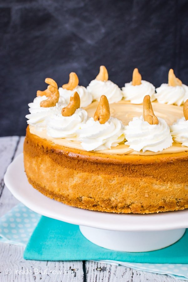 Caramel Cashew Cheesecake - three times the caramel makes this homemade cheesecake an impressive dessert. Perfect recipe for parties and events! #cheesecake #caramel #homemadewhippedcream #recipe #cashews