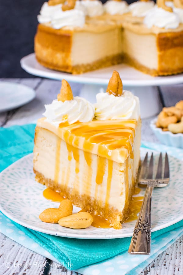 Caramel Cashew Cheesecake - three times the caramel makes this homemade cheesecake a delicious and impressive dessert. Try this easy recipe for parties or events! #cheesecake #caramel #homemadewhippedcream #recipe #cashews