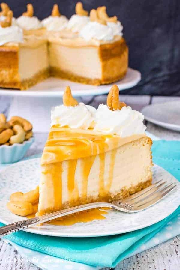 Caramel Cashew Cheesecake - this creamy homemade cheesecake has three times the caramel. The cashew crust gives it such a great flavor. Try this recipe for parties and events. #cheesecake #caramel #homemadewhippedcream #recipe #cashews