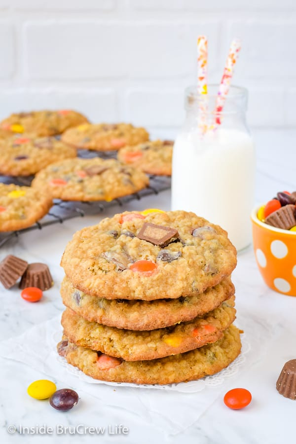 A stack of peanut butter oatmeal banana cookies with more cookies behind it