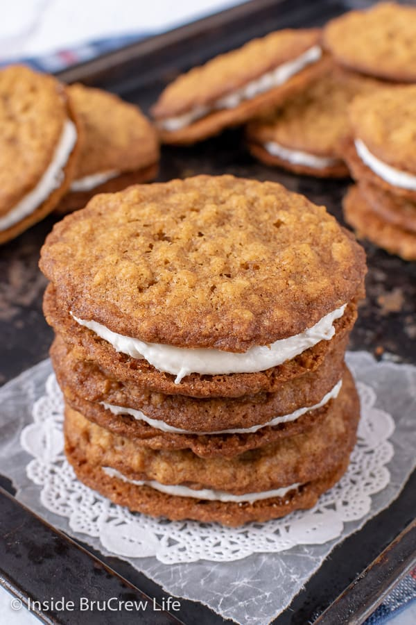 Homemade Oatmeal Cream Pies - soft chewy oatmeal cookies filled with a marshmallow filling tastes so much better than the store bought snack cakes. Great copycat recipe for bake sales or after school snacks.