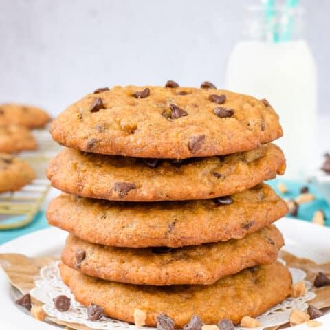 A stack of banoffee chocolate chip cookies stacked on a white plate