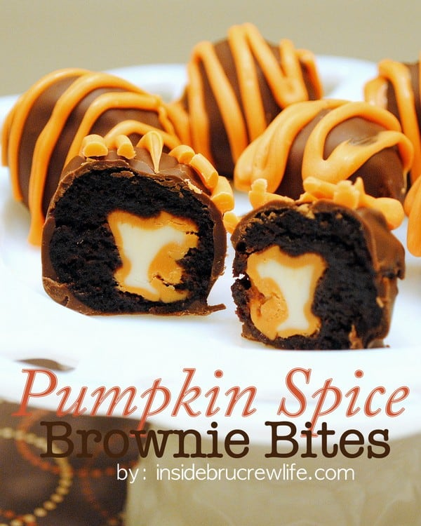 Pumpkin Spice Brownie Bites - Pumpkin spice kisses wrapped in a brownie and dipped in chocolate makes a fun and creative fall truffle.