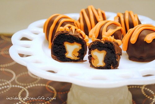 Pumpkin spice kisses wrapped in a brownie and dipped in chocolate for a fun and creative truffle.