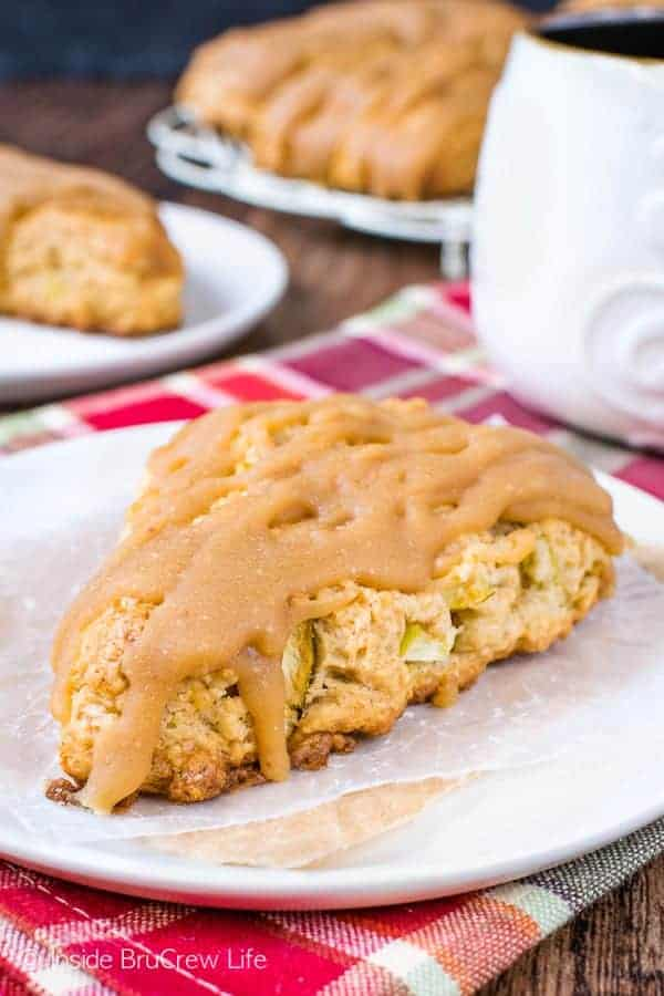 Caramel Apple Scones - soft, flakey scones filled with apple chunks and drizzled with a sweet caramel glaze makes a delicious breakfast. Try this recipe this fall! #scones #apple #caramel #homemade #recipe #fall #breakfast