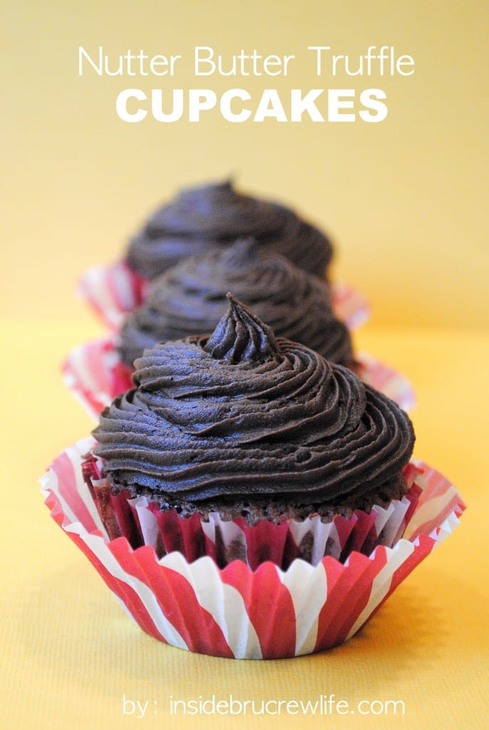 Nutter Butter Truffle Cupcakes - easy brownie cupcakes filled with Nutter Butter cookie truffles and topped with chocolate frosting. Make this fun stuffed cupcake recipe for events and dinner parties! #brownies #chocolate #peanutbutter #frosting