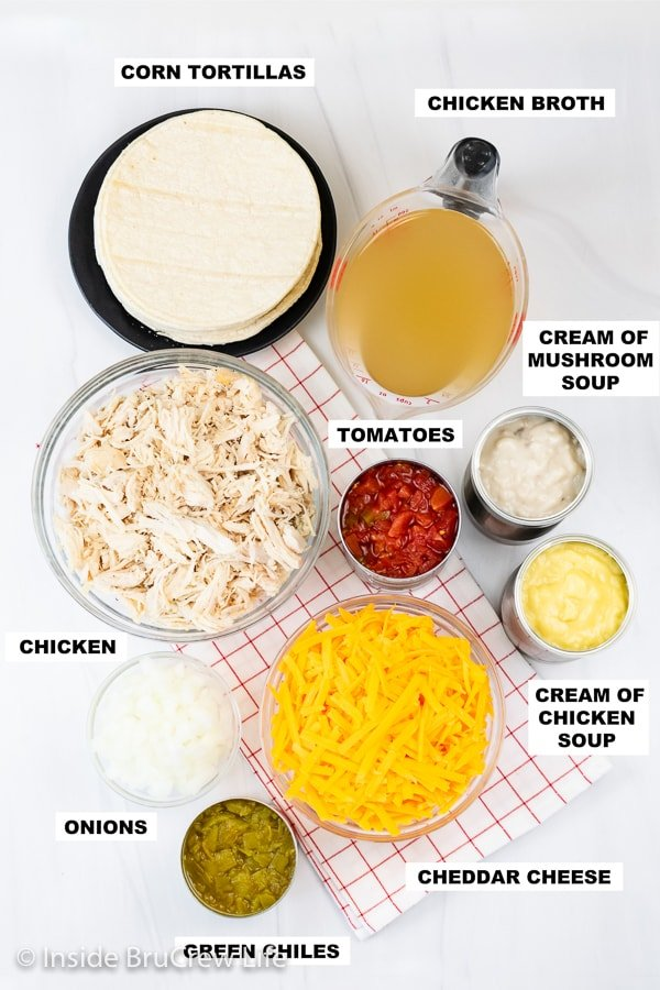 Overhead picture of a white board with bowls of ingredients to make chicken ole.