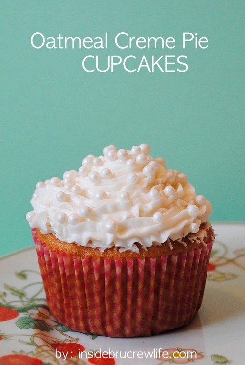 Oatmeal Creme Pie Cupcakes - the fun vanilla cupcakes have a hidden cookie surprise