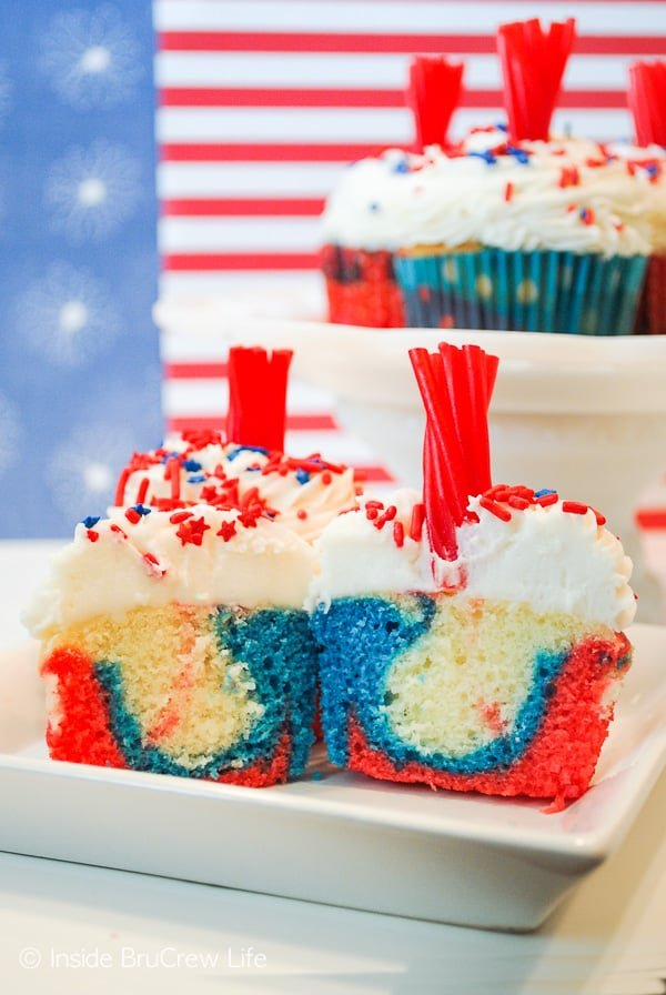 Firecracker Cupcakes - the red, white, and blue center makes these cupcakes a fun treat for Fourth of July parties. This is an easy recipe to make with your kids this summer. #cupcakes #fourthofjuly #redwhiteandblue #frosting #firecrackers #holiday #summerdesserts