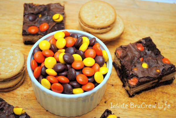 Oreo Reese's Brownies - brownies stuffed with golden Oreos and Reese's Pieces are the way to go for dessert