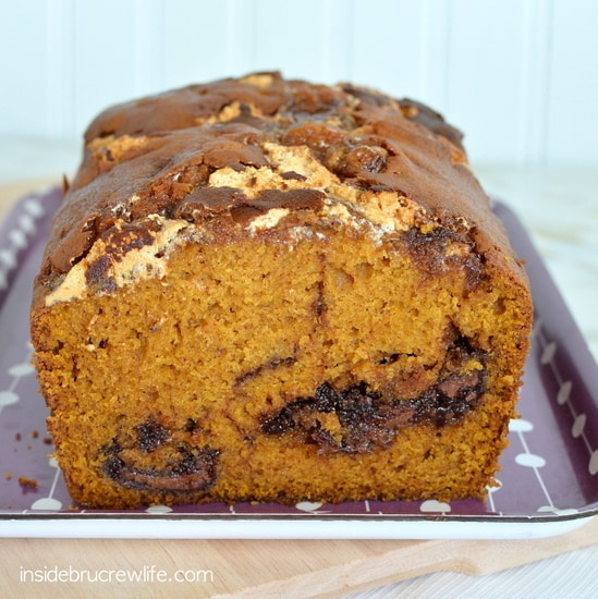 Swirls of chocolate and marshmallow make this Nutella Marshmallow Pumpkin Bread disappear in a hurry. Great fall breakfast recipe!
