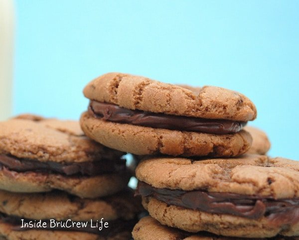 A stack of Andes Mint Filled Cookies with a blue background