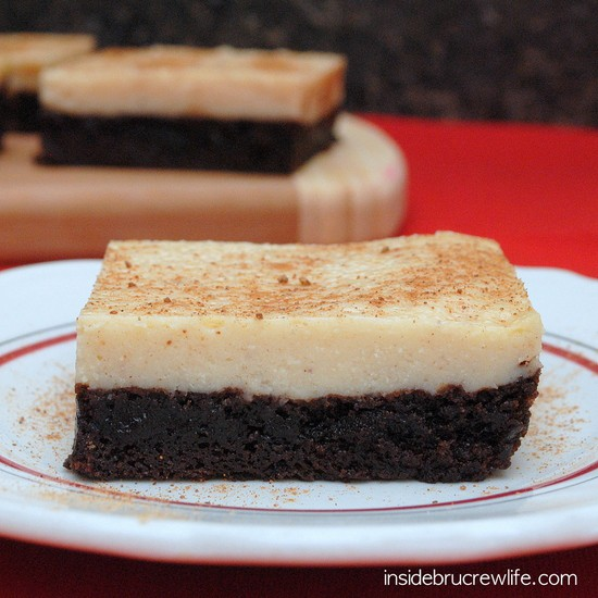 Layer of brownies and eggnog cheesecake is a delicious holiday dessert.