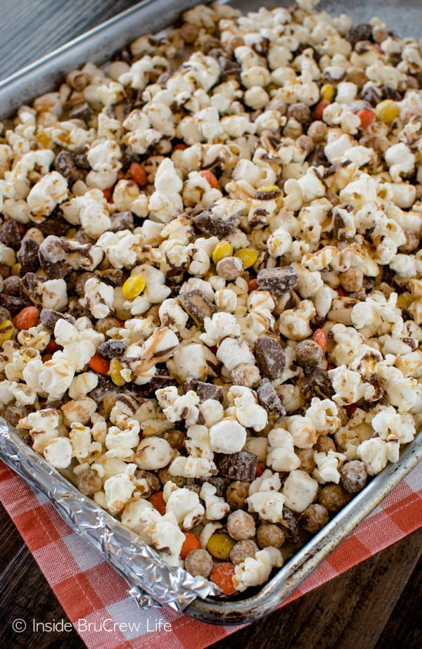 Lots of chocolate and peanut butter makes this Reese's Popcorn a fun snack mix to make and eat!