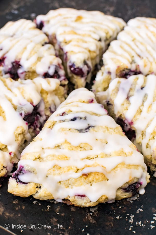 Blueberry Coconut Scones - soft fluffy scones loaded with blueberries and coconut. The glaze on top adds a sweet flair. Make this easy recipe for summer breakfast or brunch! #breakfast #scones #blueberry #coconut #pastries #homemade #recipe #easy
