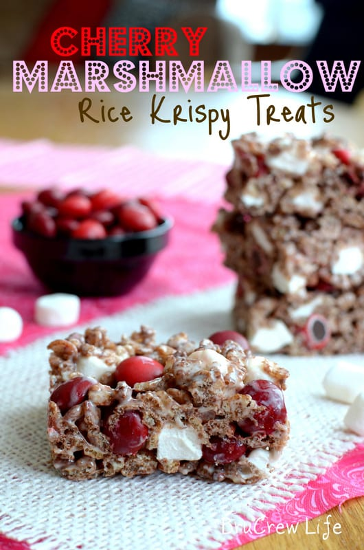A stack of Cherry Marshmallow Rice Krispie Treats on a piece of white burlap with a square in the front