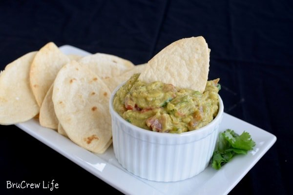 Guacamole Hummus with Football Chips - homemade football shaped chips are perfect for digging into this chunky dip. Great recipe for game day parties!