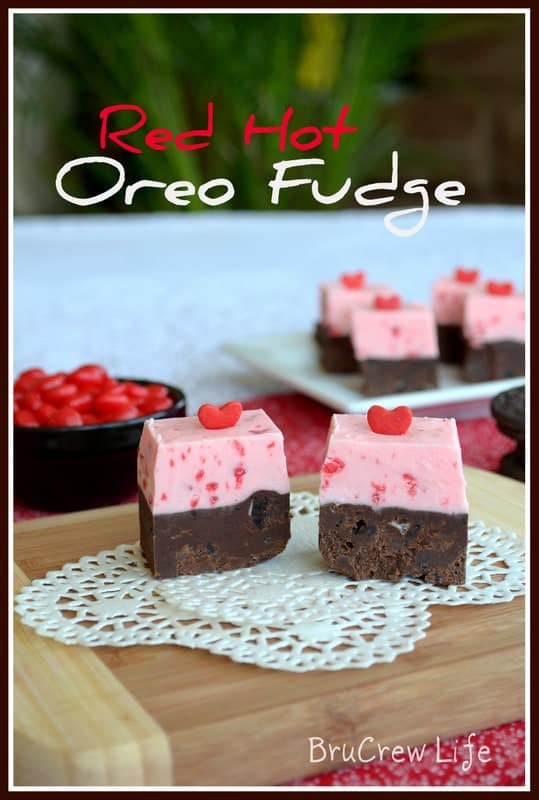 This easy fudge has Oreo cookies and Red Hot candy bits mixed into each layer! It's so pretty and delicious!