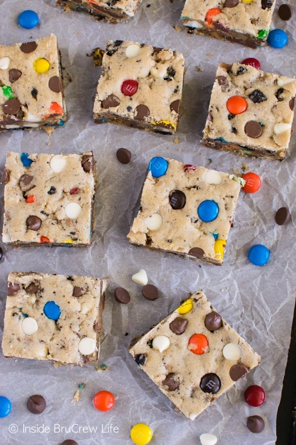 Candy bars, cookie chunks, and chocolate chips give these Loaded Blonde Brownies some fun color and crunch! Great dessert recipe!