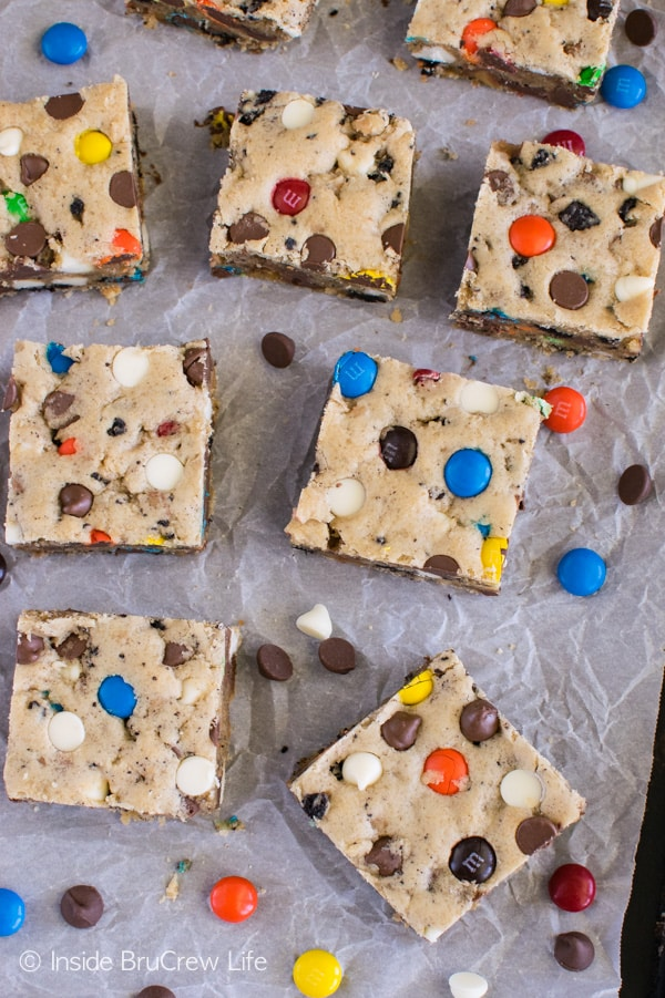 Loaded Blonde Brownies - candy bars, cookie chunks, and chocolate chips give these cookie bars some fun color and crunch! Make this easy recipe for dessert or bake sales.