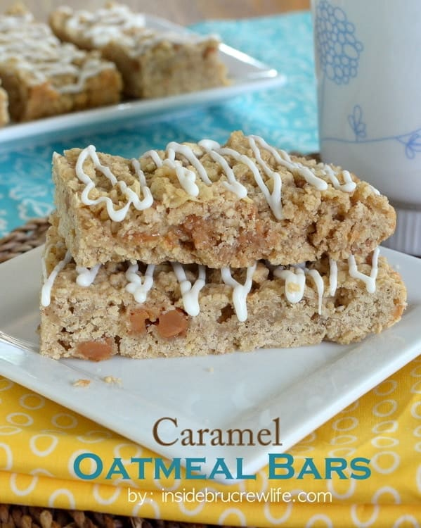 Two caramel oatmeal bars stacked on a white plate