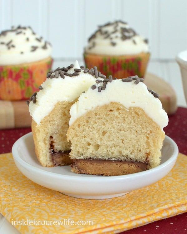 Reese's Fluffernutter Cupcakes - peanut butter cupcakes with a hidden peanut butter cup and topped with marshmallow butter cream  http://www.insidebrucrewlife.com
