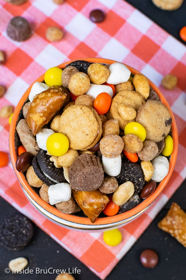 Sweet and Salty Trail Mix - sweet cookies and candies and salty pretzels and peanuts make this homemade snack mix disappear in a hurry! Great recipe for family game nights or movie nights! #snackmix #trailmix #reeses #peanutbuttercups #sweetandsalty #nobake