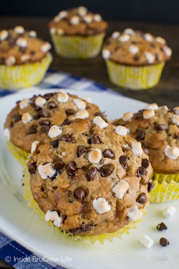 Marshmallows, chocolate, and graham crackers make these easy Banana S'mores Muffins a great breakfast recipe!