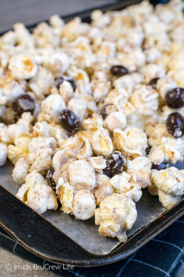 Coffee Toffee Popcorn - coffee boosted white chocolate adds a sweet flavor to this easy no bake popcorn. Make this recipe when you need a caffeine boost to get through movie night. #coffee #snackmix #popcorn #toffee #nobake #whitechocolate #coffeebeans