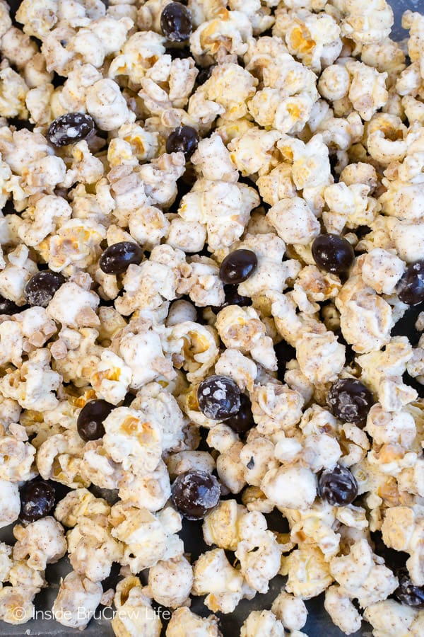 Coffee Toffee Popcorn - coffee infused white chocolate and coffee beans give this snack mix an awesome coffee boost. Make this no bake treat to munch on during movie nights. #coffee #snackmix #popcorn #toffee #nobake #whitechocolate #coffeebeans