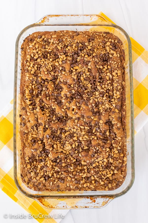 Overhead picture of a banana toffee cake in a glass baking dish on a white background
