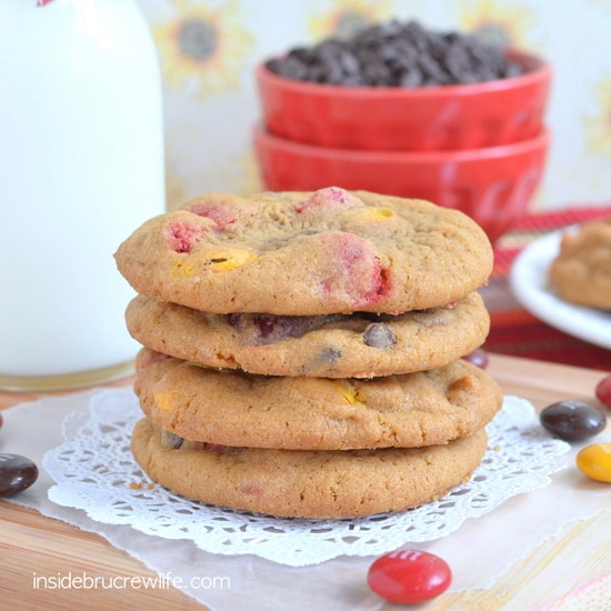 M&M Pumpkin Pudding Cookies - candies and chocolate chips make these soft cookies disappear in a hurry. Great recipe to fill the cookie jar with this fall.