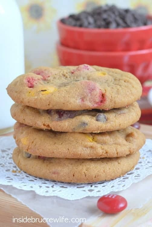 M&M Pumpkin Pudding Cookies - soft chewy cookies loaded with chocolate chips and colored M&M candies make a great fall treat. Easy recipe to fill the cookie jar with!