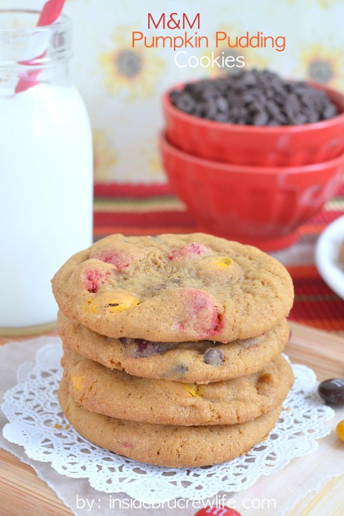 M&M Pumpkin Pudding Cookies - cookies loaded with candies and chocolate chips make a great late night snack. Easy recipe to fill the cookie jar with this fall.