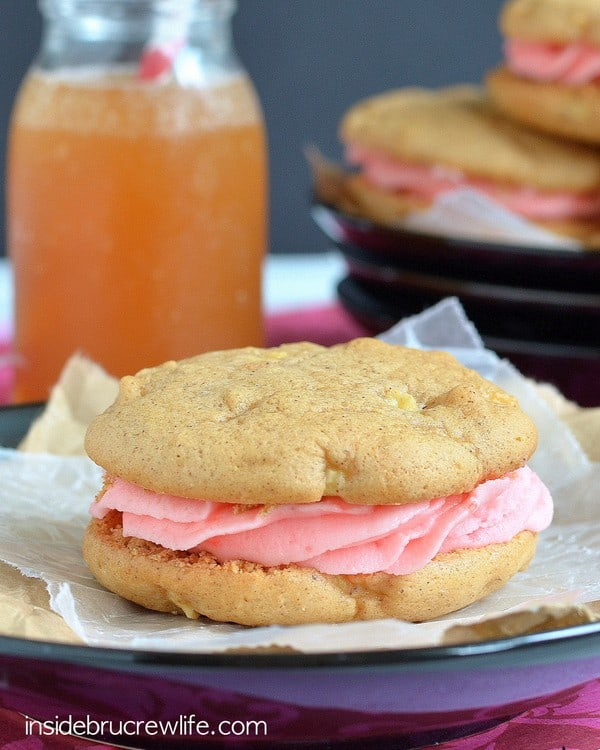 Apple Cider Whoopie Pies - apple cookies filled with cinnamon red hot frosting  http://www.insidebrucrewlife.com