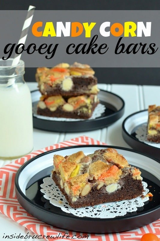 Candy Corn Gooey Cake Bars - chocolate cake crust topped with Oreos and candy corn M&M candies