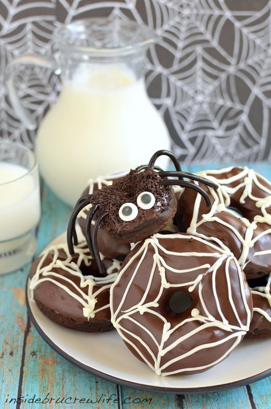 Licorice and candy eyes make these Chocolate Pumpkin Spider Donuts a fun breakfast treat for Halloween parties!