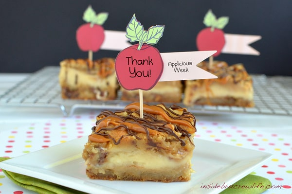 Caramel Apple Milky Way Cheesecake Bars - cookie bars made with Milky Way candy bars and filled with cheesecake https://www.insidebrucrewlife.com
