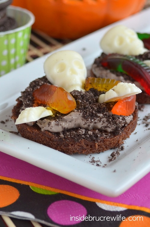 These mini brownie pizzas are topped with pudding, Oreo cookies, and spooky candies.  Kids go crazy for them!!!