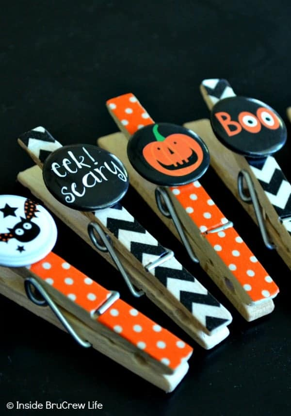 Halloween Washi Magnet Clips - clothes pins, washi tape, and stickers make a cute little magnet for your fridge. Make this easy Halloween craft with your kids! #halloween #kidscrafts #magnets #easycraft