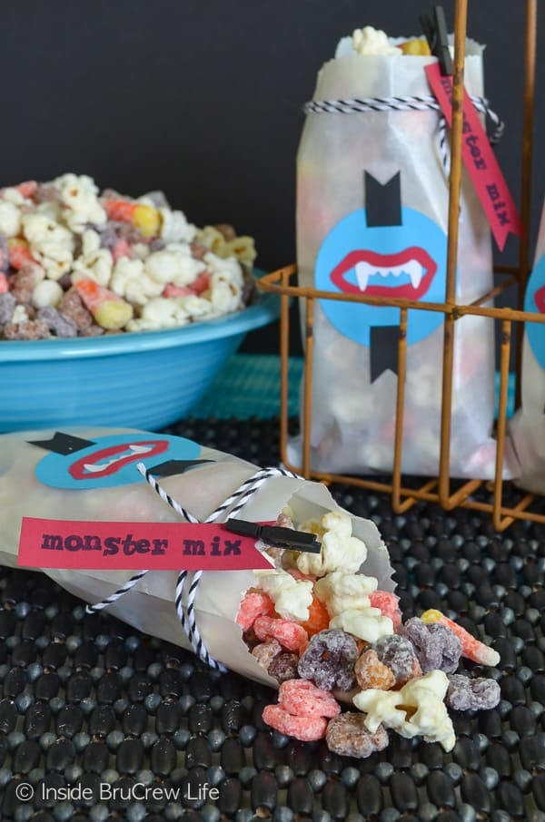 Monster Mix Popcorn - popcorn, cereal, peanuts, and candy corn covered in white chocolate makes a great snack mix for Halloween parties! #snackmix #popcorn #candycorn #peanuts #whitechocolate #halloween #halloweenparties