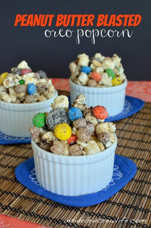White Chocolate and peanut butter covered popcorn with Oreo cookies and M&M candies is a great movie night snack.