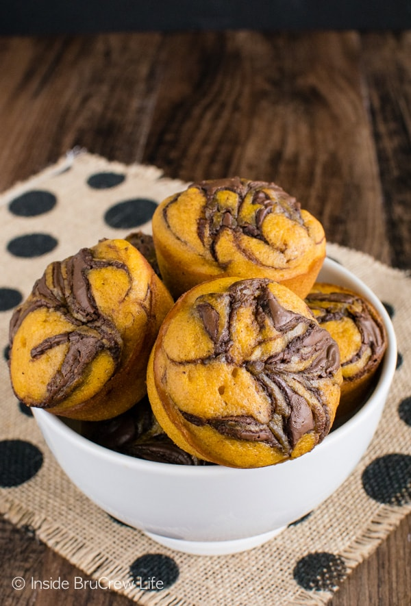 Chocolate swirls make these Pumpkin Nutella Muffins disappear every time. Great breakfast recipe!