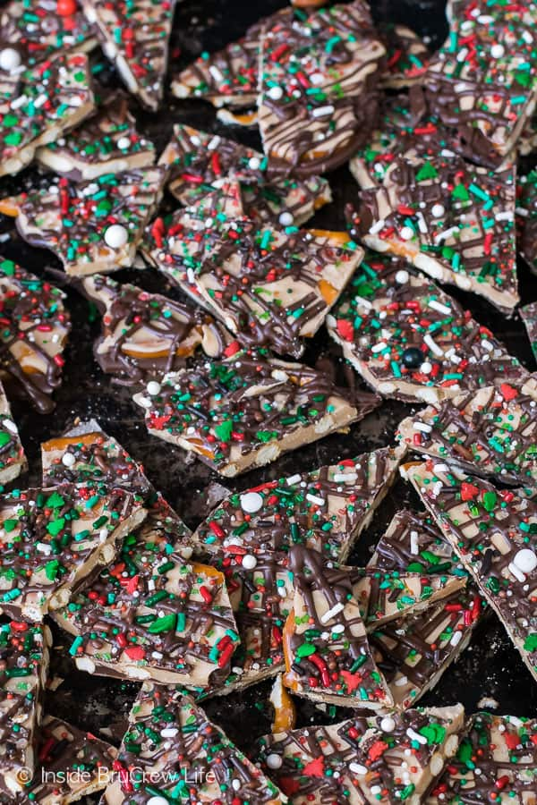 Salted Caramel Pretzel Bark - pretzels coated in two kinds of chocolate and sprinkles make this a great sweet and salty treat. Awesome recipe for holiday parties! #chocolate #saltedcaramel #bark #candy #sweetandsalty #easy #holidaycandy