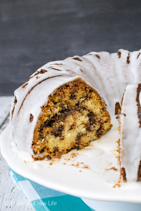 Sour Cream Chocolate Chip Coffee Cake - this sweet bundt cake has swirls of cinnamon sugar and chocolate chips inside it. This is a great recipe to make for breakfast or brunch. #breakfast #coffeecake #bundtcake #sweet #recipe #brunch