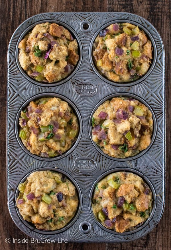 Overhead picture of a a muffin tin with stuffing muffins baked in it