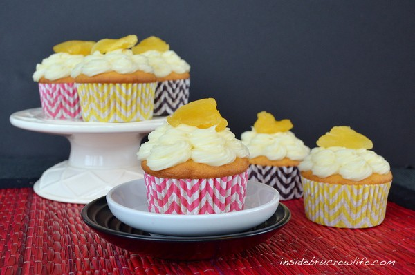 Pineapple Cupcakes - vanilla cupcakes filled with pineapple preserves and topped with cream cheese frosting