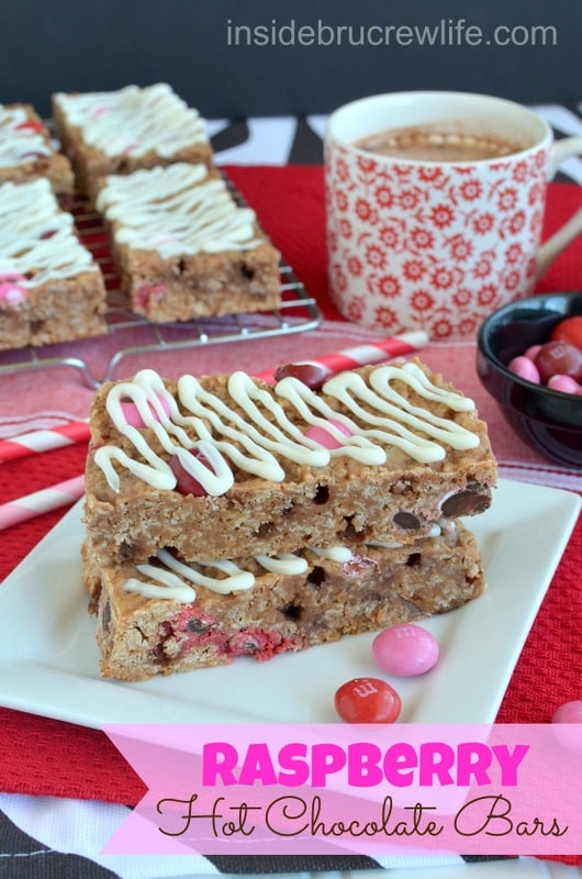 A stack of two Raspberry Hot Chocolate Granola Bars on a white plate